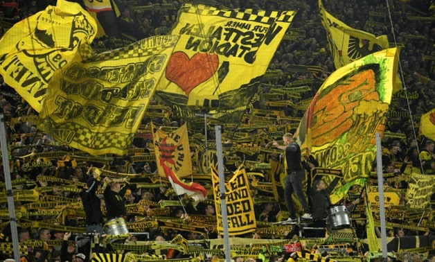 """Borussia Dortmund's """"Yellow Wall"""" -- the South Stand at Signal Iduna Park -- has been described as a 'gigantic monster' ready to intimidate opposing teams."""