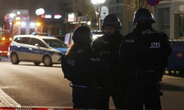 Police officers secure the area after a shooting in Hanau near Frankfurt, Germany. Photograph: Kai Pfaffenbach/Reuters