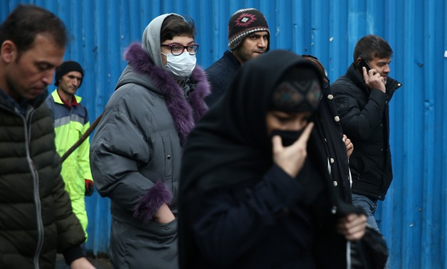 An Iranian woman wears protective mask to prevent contracting a coronavirus, as she walks at Grand Bazaar in Tehran, Iran February 20, 2020. WANA (West Asia News Agency)/Nazanin Tabatabaee via REUTERS