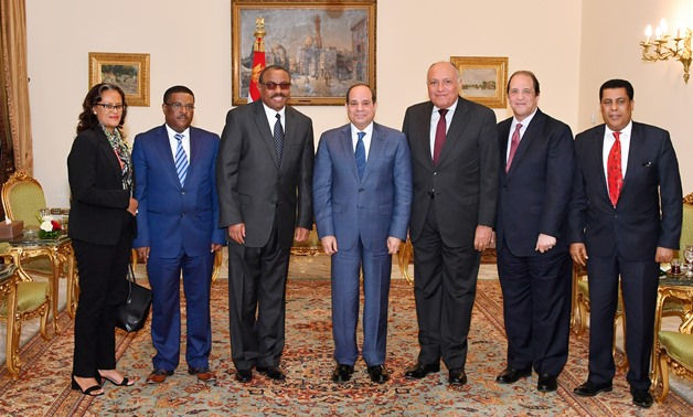 President Abdel Fatah al-Sisi, Hailemariam Desalegn, the special envoy of Prime Minister Abiy Ahmed on Saturday and other Egyptian and Ethiopian diplomats and officials pose for a photo, February 23, 2020 at the Presidential Palace in Cairo- Press photo