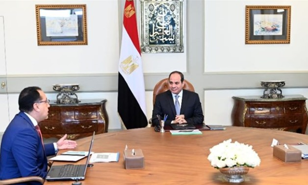 Meeting with Prime Minister Mostafa Madbouli and Environment Minister Yasmin Fouad, Sisi urged considering international standards and designs when formulating development projects for natural reserves - Press photo