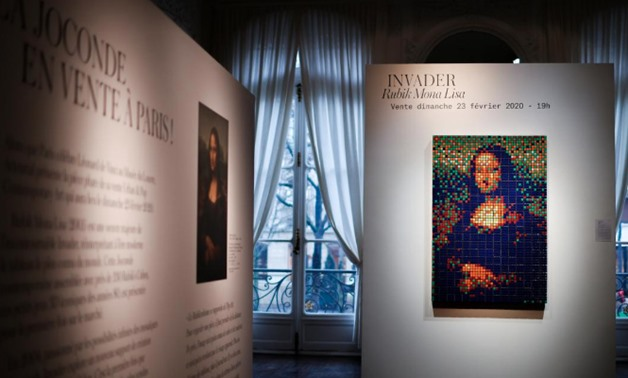 The Rubik Mona Lisa (2005) by French street artist Invader is displayed at ArtCurial in Paris, France, February 3, 2020. REUTERS/Gonzalo Fuentes