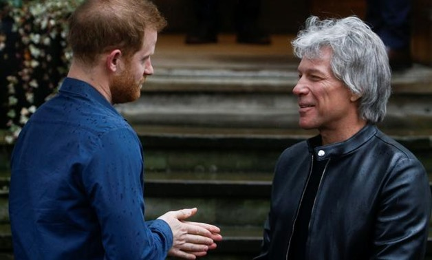 Britain's Prince Harry and singer Jon Bon Jovi recreated one of the Beatles' best-known album covers on Friday - Reuters