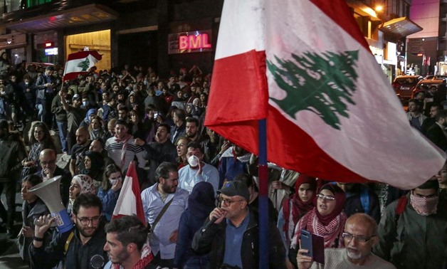 Lebanese anti-government protesters marching towards downtown Beirut on Thursday. Financial Prosecutor Ali Ibrahim had issued an order freezing the assets of 20 banks, which caused the banks to threaten to close.  EPA