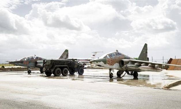 Russian Sukhoi Su-25 fighter jets are shown shortly before takeoff at Hmeimim air base in Syria. (Photo by Reuters)