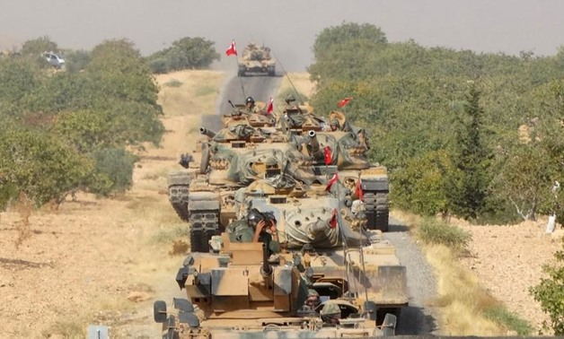 Turkish army tanks make their way towards the Syrian border town of Jarablus, Syria August 24, 2016. Revolutionary Forces of Syria Media Office/Handout via REUTERS