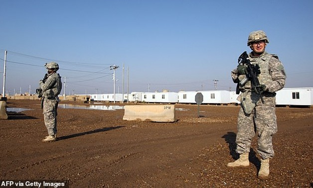 US soldiers walk around at the Taji base complex in Iraq which hosts Iraqi and US troops (pictured in 2014).