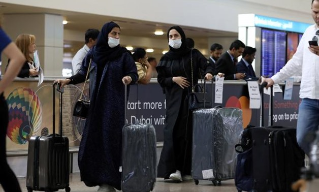 FILE PHOTO: Travellers wear masks as they arrive at the Dubai International Airport, after the UAE's Ministry of Health and Community Prevention confirmed the country's first case of coronavirus, in Dubai, United Arab Emirates January 29, 2020. REUTERS/Ch