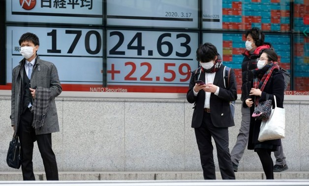 Tokyo stocks opened higher on Wednesday, extending rallies on Wall Street as the US and European governments signalled more stimulus measures to address the economic hit from the coronavirus. PHOTO: AFP