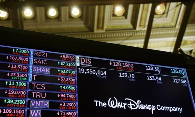 FILE PHOTO: The logo of the Walt Disney Company is displayed above the floor of the New York Stock Exchange shortly after the closing bell as the market takes a significant dip in New York, U.S., February 25, 2020. REUTERS/Lucas Jackson.