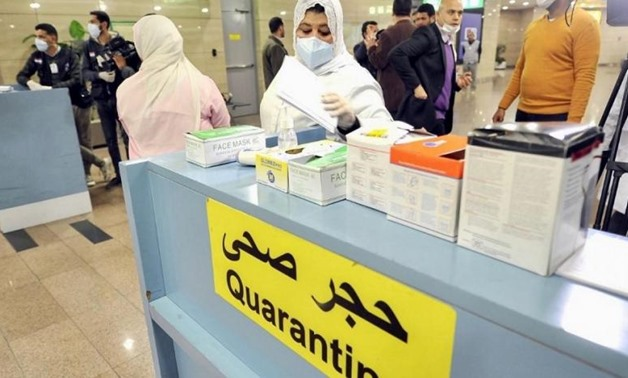 FILE- Egyptian Quarantine Authority employees at Cairo International Airport last month. (AFP)