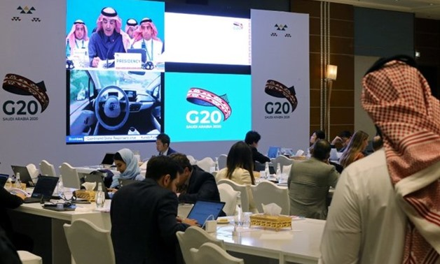 FILE PHOTO: Journalists sit in the media center during the meeting of G20 finance ministers and central bank governors in Riyadh, Saudi Arabia, February 22, 2020./File Photo - REUTERS