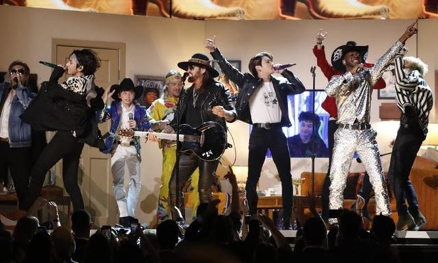FILE PHOTO: 62nd Grammy Awards - Show - Los Angeles, California, U.S., January 26, 2020 - Lil' Nas X and Billy Rae Cyrus perform with South Korea's BTS. REUTERS/Mario Anzuoni.