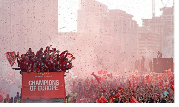 Liverpool's team bus travels past fans during the team's Champions League victory parade in Liverpool, Britain, June 2, 2019. REUTERS/Phil Noble
