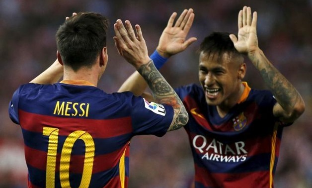 Barcelona's Lionel Messi (L) celebrates with team Neymar after scoring a goal against Atletico Madrid during their Spanish first division soccer match at Vicente Calderon stadium in Madrid,12 September, 2015.REUTERS/Javier Barbancho