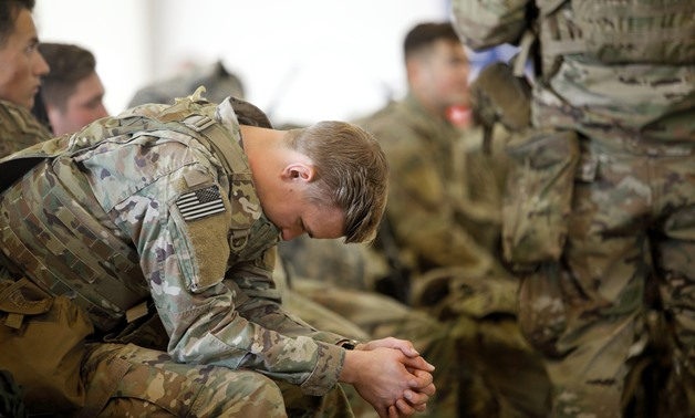 A U.S. Army paratrooper with the 82nd Airborne Division preparing to leave Fort Bragg, N.C., on Wednesday. Reuters
