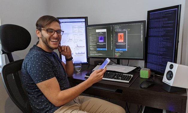 Luke Tsekouras, a site reliability engineer, working on his newly popular games website netgames.io, is seen at his home in Sydney, New South Wales, Australia April 9, 2020, in this handout image. Luke Tsekouras/Handout via REUTERS