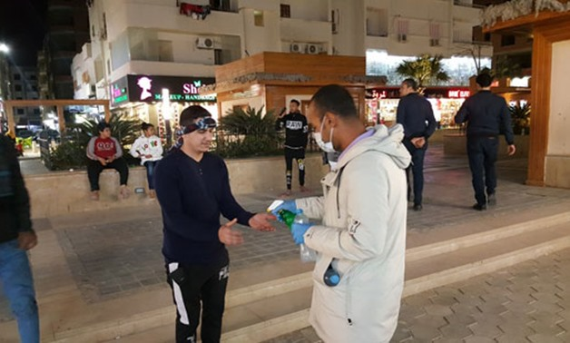 FILE- Youth in Hurghada have organized an initiative to help clean and sterilize streets and facilities, to face the spread of the novel coronavirus – Egypt Today