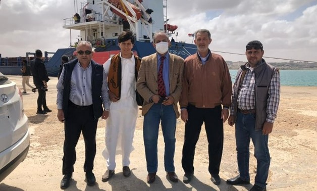 Libyans receive 44 containers of detergents sent by Egypt upon arrival in Tobruk Port on April 11, 2020 – Press Photo