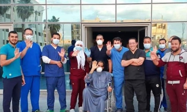 60-year-old patient leaving quarantine hospital in Helwan after recovering from COVID-19 – Press Photo