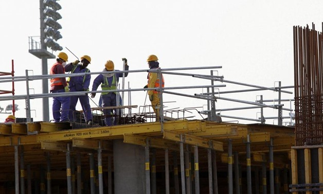 FILE - Foreign workers on the Aspire Zone, a multi-sport venue in Doha - Reuters