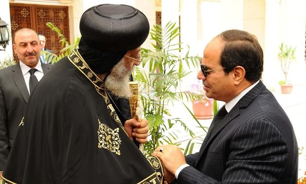 President Abdel Fattah El Sisi, right, shakes hands with Pope Tawadros II, left, at the Abassiya Cathedral in Cairo on April 13, 2017. The Egyptian presidency / Handout via Reuters