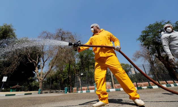 A zoo employee wearing full protective gear sprays disinfectant at the closed Giza Zoo, during the spread of coronavirus disease (COVID-19) on the outskirts of Cairo, Egypt April 8, 2020. REUTERS/Amr Abdallah Dalsh