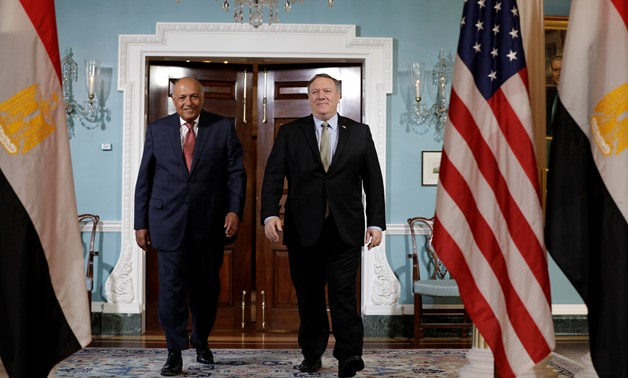 FILE - US Secretary of State Mike Pompeo shakes hands with Egyptian Foreign Minister Sameh Shoukry before their meeting at the State Department in Washington, US, August 8, 2018. REUTERS/Yuri Gripas