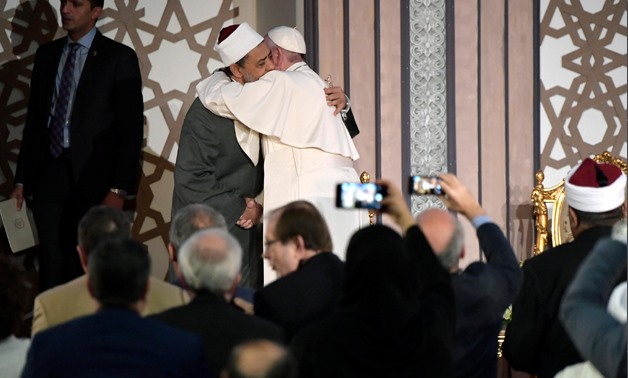FILE- Pope Francis of the Vatican extends his greetings to Grand Imam of Al Azhar and Chairman of the Muslim Council of Elders Ahmad el Tayeb in April 2017 in Cairo- press photo