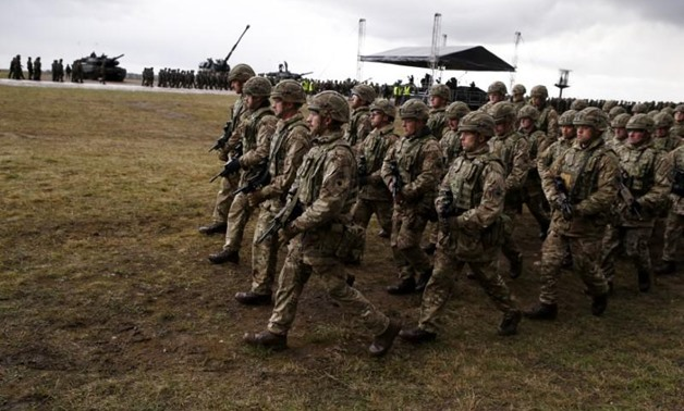 FILE PHOTO: British soldiers attend welcoming ceremony for U.S.-led NATO troops at polygon near Orzysz, Poland, April 13, 2017. REUTERS/Kacper Pempel