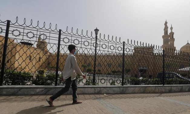 A man walks past the closed al-Azhar Mosque in Cairo which has been closed along with other places of worship to stop the spread of coronavirus in Egypt. (Reuters)