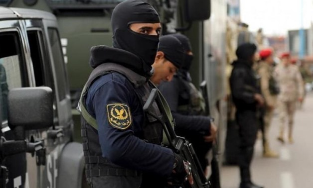 FILE - Security forces stand guard in Alexandria in northern Egypt - Reuters