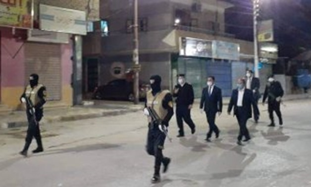 FILE - Egyptian police patrolling streets during curfew imposed as a protective measure against the spread of COVID-19 - Egypt Today