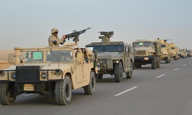 FILE- Egyptian Army's armored vehicles on a highway to North Sinai - Reuters