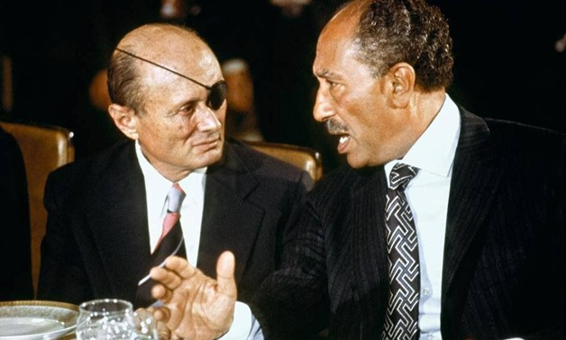 Late President Anwar al-Sadat and Late Israeli Defense Minister Moshe Dayan talking while the former was visiting Jerusalem in November 1977 within peace talks rounds – Archive