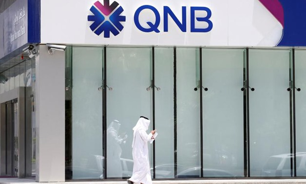 A man walks past a branch of Qatar National Bank (QNB) in Riyadh - Reuters