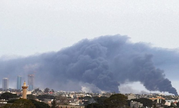 Smoke fumes rise above buildings in the Libyan capital, Tripoli, during shelling on May 9, 2020. (AFP Photo)