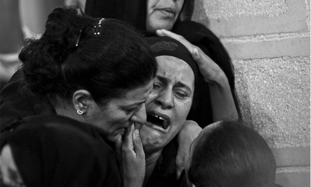 Families of Minya attack victims crying during their funeral - Hussein Tallal