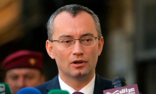FILE - UN Middle East envoy Nickolay Mladenov is seen talking to press in Najaf, Iraq on March 3, 2015 (Reuters)