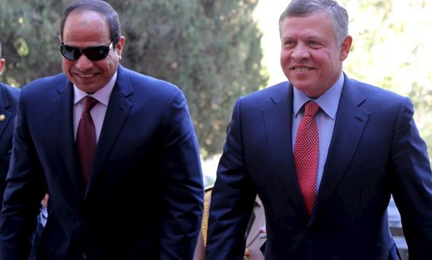 FILE - Jordan's King Abdallah II walks with Egypt's President Abdel Fattah El-Sisi in Amman, Jordan. (Reuters)