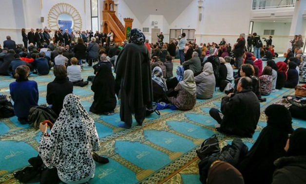 Several hundred people, Muslims and non-Muslims, gather to pray at the Grande Mosque in Lyon, France, November 15, 2015, for the victims of the series of shootings in Paris on Friday. REUTERS/Robert Pratta