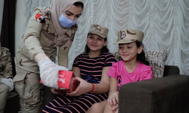 Armed forces personnel give gifts to relatives of martyrs on the occasion of Eid- al-Fitr on Sunday, May 24, 2020- press photo