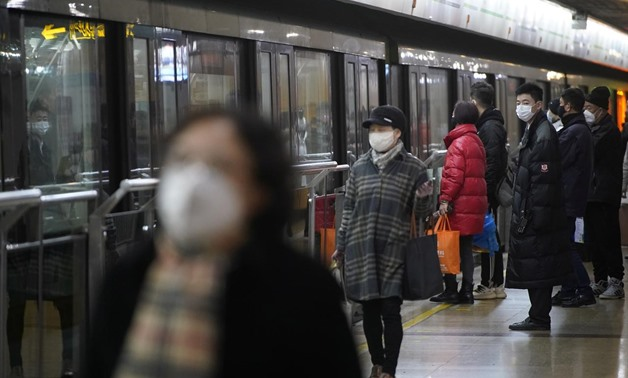 FILE PHOTO: People wearing protective masks are seen at a subway station in Shanghai, China January 23, 2020. REUTERS/Aly Song