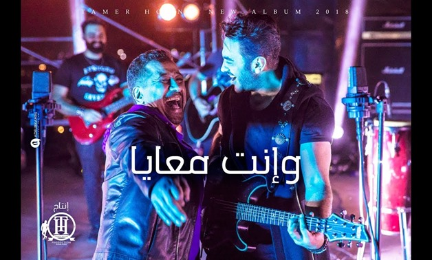 File - Super stars Tamer Hosny and Cheb Khaled.