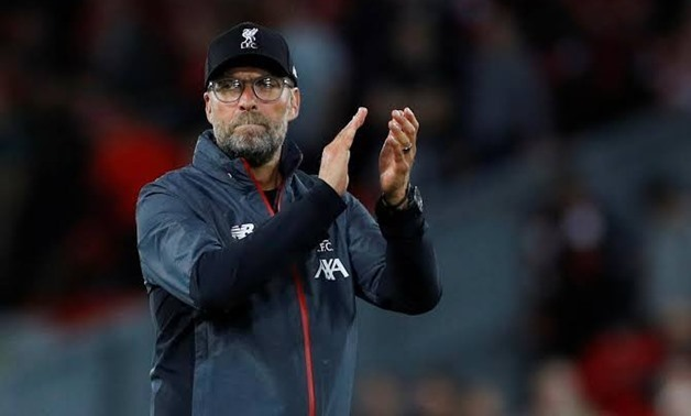 Soccer Football - Premier League - Liverpool v Norwich City - Anfield, Liverpool, Britain - August 9, 2019 Liverpool manager Juergen Klopp applauds their fans as he celebrates after the match REUTERS/Phil Noble