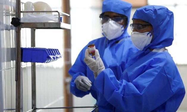 FILE PHOTO: Medical staff with protective clothing are seen inside a ward specialised in receiving any person who may have been infected with coronavirus, at the Rajiv Gandhi Government General hospital in Chennai, India, January 29, 2020. REUTERS/P. Ravi