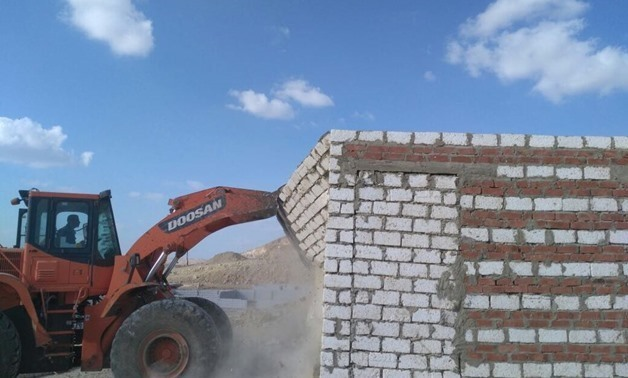 FILE - Government removed an illegal building on agricultural lands- Press photo/ Ministry of Water Resources and Irrigation