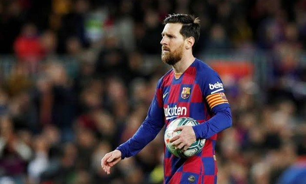 FILE PHOTO: Soccer Football - La Liga Santander - FC Barcelona v Real Sociedad - Camp Nou, Barcelona, Spain - March 7, 2020 Barcelona's Lionel Messi prepares to take a penalty REUTERS/Albert Gea