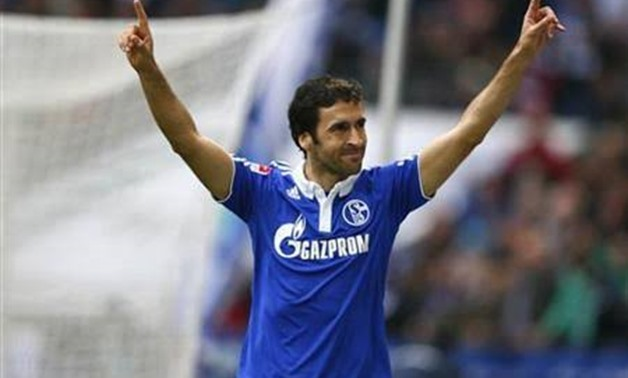 Raul of Schalke 04 celebrates his second goal against Hanover 96 during their German first division Bundesliga soccer match in Gelsenkirchen, April 8, 2012. REUTERS/Kai Pfaffenbach