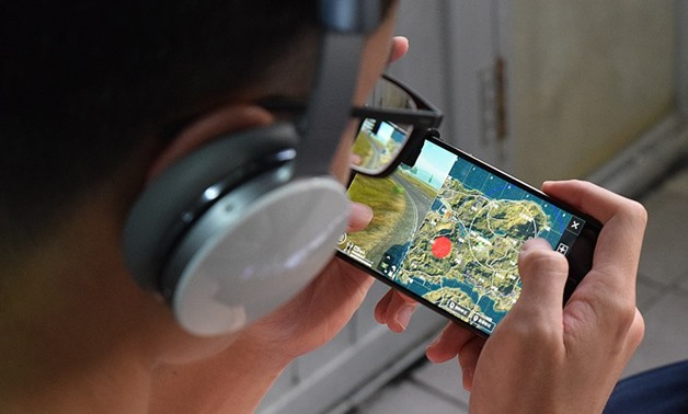 FILE - A player playing PUBG on mobile - Wikimedia Commons/Sparktour